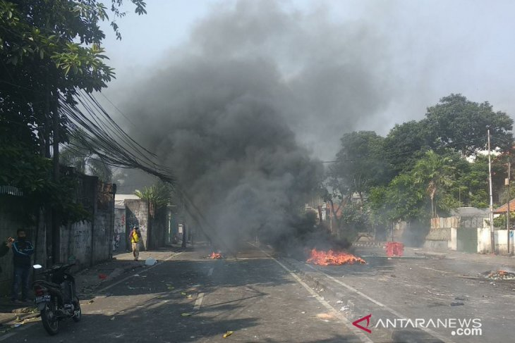 Post-election rioting in Jakarta six people died, 20 provocateurs arrested