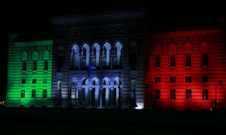 Sarajevo City Hall illuminated in the colors of Italian flag