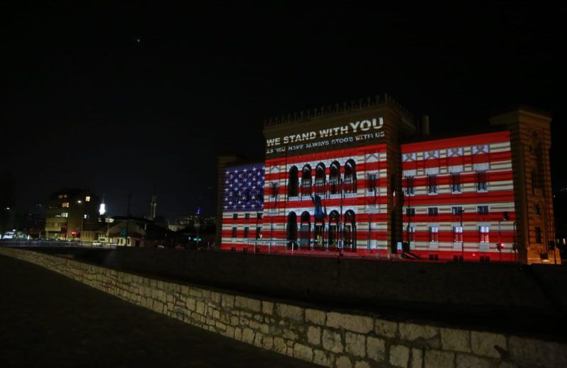 Sarajevo City Hall illuminated in the colors of the flag of the United States