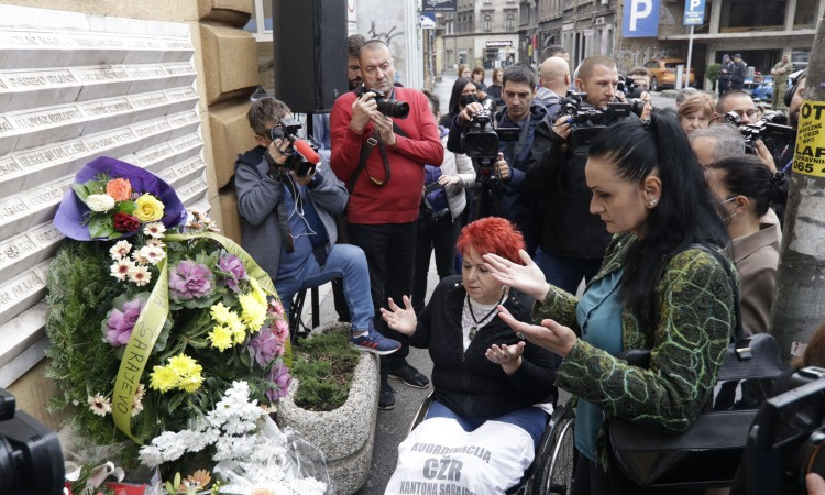 Flowers, prayers and a minute of silence for those killed at Markale City Market